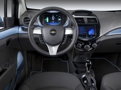 Electronic displays and telecommunications links in the 2014 Chevy Spark EV battery car will shame some premium machines. Another reason it was the years big surprise. -- Chevrolet