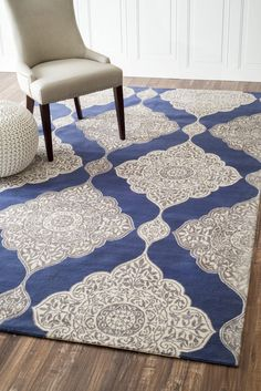 Fascinating Rug Area Ideas With Cozy Nuloom Rugs: Awesome Grey And Blue Nuloom Rugs On Natural Wood Floroing And White Chusion Chairs Also Side White Pouf Design