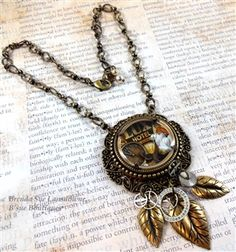 shadow box, magnifying lens, handmade, necklace, boho jewelry, Brenda Sue Lansdowne, antique brass, bead and link chain, leaves, pendant, one of a kind, video necklace, jewelry making videos