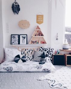 A comfy bohemian-style floor lounge is the perfect place for your toddler to catch a quick snuggle or curl up with a well-loved picture book. Create a cozy nest for your little one with rich furs and shaggy rugs, or use a mattress pad to create a simple floor bed. Don't forget to cover your creation with lots of fluffy throw pillows!
