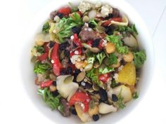 Roast capsicum, pear, artichoke, anchovies, chickpea, currants, pepitas and quinoa salad with parsley