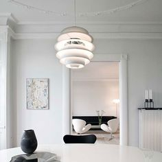 PH Snowball pendant by Louis Poulsen, black and white living room