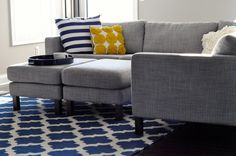 Gray and navy living room. That's what i'll do. Been wondering what color to pair with my grey couches.