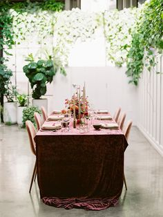 This colorfully creative microwedding was planned in less than 48 hours, can you believe it? Now, more than ever, couples are needing to plan last minute weddings with their nearest and dearest. But that does not mean you have to sacrifice a gorgeous aesthetic and one heck of a good time! This San Diego elopement with only 4 guests is living proof with a mid-century style tablescape and pink velvet chairs, a vibrant bridal bouquet with garden roses and cafe dahlias and a painted teal watercolor