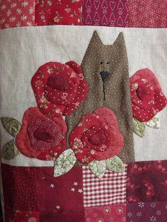 Cat in the roses
