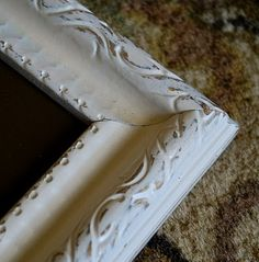 This frame was originally gold, and because I wanted a distressed look with a hint of brown showing through, I chose Metallic Rich Espresso paint.  You can also distress using a glaze.  See tutorial at Take the Side Street.