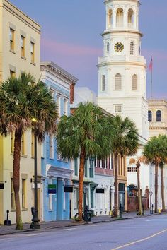RAINBOW ROW, SOUTH CAROLINA: We're not sure a more photogenic stretch of street exists. The pastel-colored homes and the feathery sabal palms of charming Charleston are ridiculously beautiful—no filter necessary. Cheap Family Vacations, Summer Vacations, Where Is Bora Bora, Jamaica Travel, Vacation Spots, Vacation Travel, Vacation Ideas, Travel Destinations, Best Places To Travel
