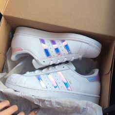 Adidas holographic superstar Brand new in box // Size 6.5 in kids, fits 7.5 or 8 in women // $100 on Ⓜ️ercari // other sizes also available, please check my profile :) Adidas Shoes Sneakers