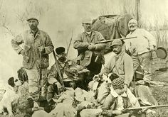 HISTORIC PHOTO - At first glance this seems to just be a photo of a group of men out hunting, but there is so much going on in this photo! The men are identified as Grant Reynard, lower left and Fred Reynard, lower right.  Steve Reynard is seated on the right, Henry Mayer standing center, Frank Powell seated center and Mark Reinecke is standing left.  Joe the camp cook is standing in the back holding a frying pan. Born in Grand Island, Nebraska in 1887, Grant Reynard began his young artistic…
