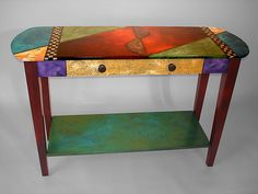 Grossman paints every surface of this imaginative wood sofa table with her signature palette of bold color and pattern, then embellishes it with embossed copper and 24k gold, silver, and copper leaf