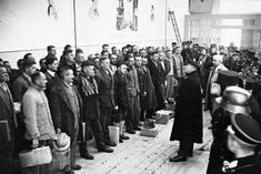 "In the early days (1933-35) there was still a real chance of actually being freed from a concentration camp. In this photo, prisoners about to be released from Dachau get an ""instructional"" speech from a camp officer. Those let go included ""reformed"" common criminals, other ""undesirables"" deemed low risk and, even, some still opposed to the regime but assessed as ""neutral"" following their ""re-education."""