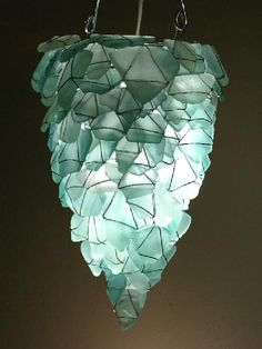 Chandelier or pendant light from aqua sea glass