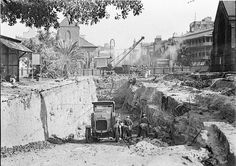 Early excavations of northern end of York St in Sydney for southern approach to the Sydney Harbour Bridge.One can see the old Scots Church on the left and St Philips on the right in the early 1930. •State Library of NSW•