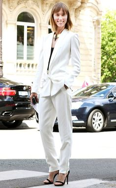 Anya Ziourova wearing: Yves Saint Laurent suit, Dior Homme top, Céline shoes, Michael Spirito necklace.