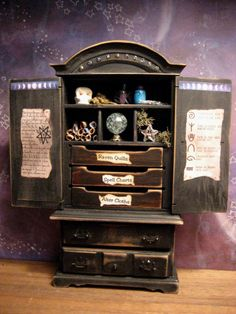 This miniature witch's cupboard is only six inches tall, and the drawers are actually full of tiny altar clothes and spells! So adorable! Would be an awesome Halloween decoration.