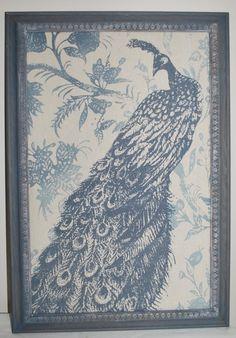 Oak frames cork board. Linen fabric with blue peacock by Junghaus