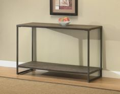 @Overstock - Offering the look of reclaimed wood, this Elements sofa table has a weathered grey oak finish. This table features non-mar foot glides and a storage shelf.http://www.overstock.com/Home-Garden/Elements-Grey-Sofa-Table-with-Shelf/5217964/product.html?CID=214117 $177.99