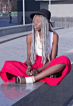 Photo - Grey hairstyle with braids, hat and colored skirt - Black women Fashion&Hairstyles