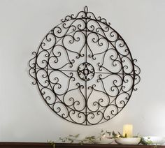 I really like this because Kevin wants a Charleston/British Colonial feel to our decor, and Charleston has a lot of wrought iron.