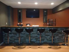 Clean Lines contemporary wet bar features accent lighting, wine frig, dishwasher, all in Castle Tree House for sale