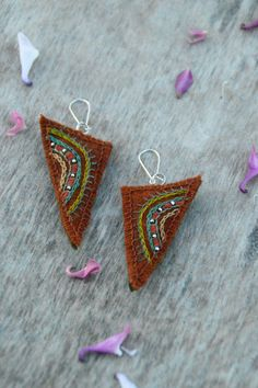 Ethnic rustic orange textile earrings. Natural and eco friendly earrings with embroidery and silver color nickel free beads.
