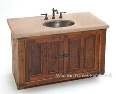 This beautiful barn wood vanity features a concrete counter top with a hand hammered under mount copper sink. The combination of distressed wood, concrete and copper is nothing short of beautiful.  The concrete tops is hand finished to resemble stone.  We offer several colors and textures for our concrete tops.  Since they are concrete coated