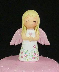 Angelita con flores .-