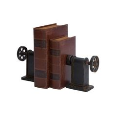 Evoking factories of a by-gone era, this vintaged metal bookend set showcases a lathe design and a rich brown finish for a look that draws the eye to your decor ensemble. Its distressed details pair perfectly with weathered framed map prints while its open wheels bring breezy flair to any space. Add this piece to the living room to complement an industrial arrangement, then pair it with exposed pipe accents and reclaimed teak wood furniture to round out the look. Perfect for flanking your…