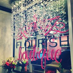 Behind the counter. Mirrored logo display at the new Flourish Boutique
