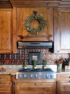Kitchen Backsplash: Awesome Wooden Cabinet Set For Kitchen Decoration With Wreath And Tin Backsplash. Creating Creative Decoration Using Tin Backsplash For Kitchens Best Kitchen Backsplash Ideas, Creative Tin Backsplash For Kitchen, Tin Tile Backsplash, Tin Tiles, Kitchen Tiles, Backsplash Ideas, Design Kitchen, Backsplash Design, Rustic Backsplash, Kitchen Cabinets, Kitchen Redo