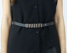 Rock the jailhouse, or just your work office, with this sassy black and gold colored rib cage embellished belt. $24