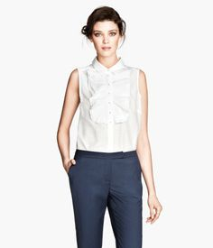 Wear tops with ruffles, lace, neck ties, etc to make your waist look smaller and make you look more feminine