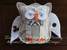this lil guy is my favorite!!!  'Lil Bro' from Sock Sisters Designs 'Patchwork Owl Nursery' mobile and decor...on etsy.com