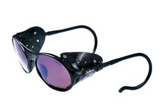 The Julbo Sherpa Glacier Sunglasses are the perfect option for budget-minded mountaineers who want to move quick and light through the alpine environment. The Spectron category 3 lens protects against the sun's harmful A, B and C UV rays. The Sherpa sunglasses offer removable side shields for ventilation, fully adjustable temple arms for a custom and comfortable fit.