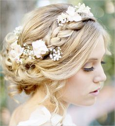Bohemian bride with loosely braided updo and floral accessories. Hair: Hair and Make-Up by Steph