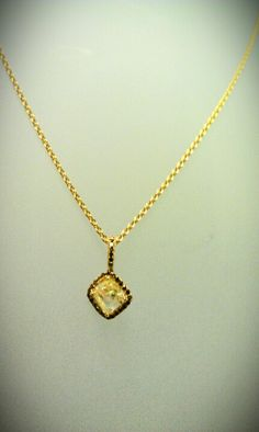Yellow diamond pendant accented with chocolate pave diamonds