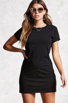 A knit T-shirt dress featuring a round neckline, cuffed short sleeves, and an open back.