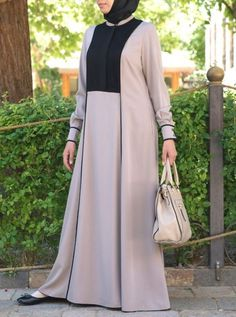 Everyday elegance is easier than you think with this gorgeous flowing abaya. The contrasting panels and subtle pleats will leave you feeling stylish all through the day. Slit pockets add a practical touch without losing any sophistication. Islamic Fashion, Muslim Fashion, Modest Fashion, Fashion Dresses, Mode Abaya, Mode Hijab, Trendy Dresses, Modest Dresses, Hijab Style Dress