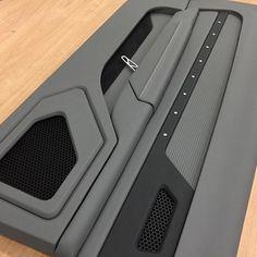 Custom built door panels for the 69 camaro grey black billet grommets. pro touring