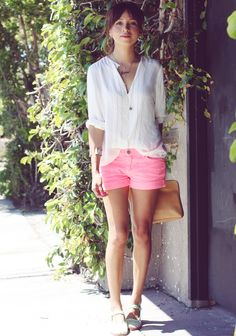 love the pink shorts and the clutch
