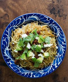 """Sopa Seca de Fideo con Tomatillo on Simply Recipes - Are you familiar with sopa seca de fideo? It's a classic Mexican side dish, made much like Mexican or Spanish rice, but instead of browning rice and cooking it in broth, you brown thin pasta noodles (fideo) and cook them in broth. """"Sopa seca"""" means """"dry soup"""" which describes the result of noodles absorbing all of the stock."""