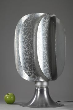A French 1970s design desk lamp composed of eight curved metal leaves on a conical curved foot...