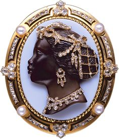 Title	Burakka Moore cameo brooch Production year	Circa 1865 Country	Unknown Authors	Unknown Material	Gold, diamonds, enamel, onyx, pearl ALBION ART