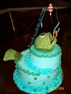 - I was asked to make a fish cake for a 10 year old boy. I used alot of ideas from Cake Central's gallery. I got the fish idea from Cookinqueen. The fish is done in fondant and the fishing pole is done is sugar paste. I then used wire for the fishing line so it would be stiff enough to dangle the hook and worm over the fish's mouth.