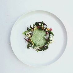 Uploaded from @connoisseurmagazine a dish from Eero Vottonen. Baby roots with burnd goat cheese soup of ramson and whey. by scandinavian_chefs
