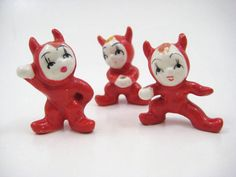 Vintage miniature red devil trio, set of 3 tiny imps, each in a unique pose. Bone china / porcelain horned devils for display, diorama, crafting, or even a devilish fairy garden.  Devils are approx. 1.5 inches tall. Theres some missing paint, minor crazing to the glaze, no chips or fleabites. Sadly these little imps have lost their pitchforks, but they are still awfully cute. Each figurine has a hole where a pitchfork would be placed. Please see images as they are part of the description...