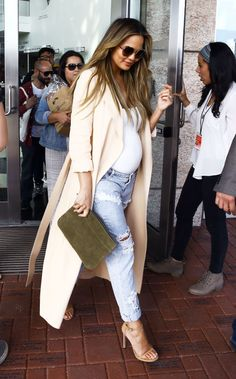 At a book signing in Miami for her foodie tome, Cravings, Teigen wore a flowing duster jacket in the faintest shade of peach over a fitted white top and One Teaspoon distressed jeans, plus nude ankle-strap sandals and an olive green suede clutch.