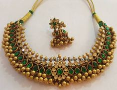 Gold solid balls embellished tussi necklace with polki diamonds and pear shaped pota emeralds. Huge jhumkas paired up with the set from S. Kids Gold Jewellery, Gold Jewelry Simple, Gold Jewellery Design, Temple Jewellery, Designer Jewellery, Craft Jewelry, Handmade Jewellery, Jewellery Box, Jewelry Patterns