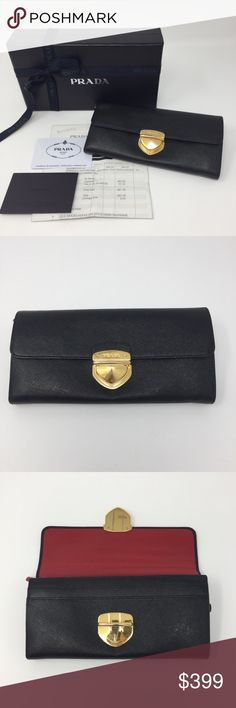 """PRADA CONTINENTAL PUSHLOCK SAFFIANO WALLET 1M1037 AUTHENTIC Prada Continental Wallet. Approx 7.5""""Wx3.5""""Hx.8""""D. Black saffiano exterior, smooth red leather interior. 1M1037. Retail for $580 in 2014. Ships with box, card & receipt (with personal info blacked out). Interior: 4 long pockets, 1 center zip pocket, 6 card slots. Made in Italy. Used regularly & displays normal wear. No rips, tears, stains to leather. Hardware, particularly front claps, displays normal wear from regular use. This…"""