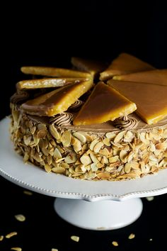 This amazing Hungarian layer cake called Dobos Torte has a fantastic buttery chocolate frosting and crazy caramel topping. Perfect for… Layer Cake Recipes, Dessert Recipes, Dessert Bread, Cupcakes, Cupcake Cakes, Hungarian Recipes, Hungarian Desserts, Croatian Recipes, Kolaci I Torte
